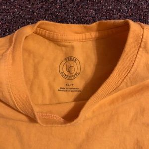 Yellow urban outfitters t shirt